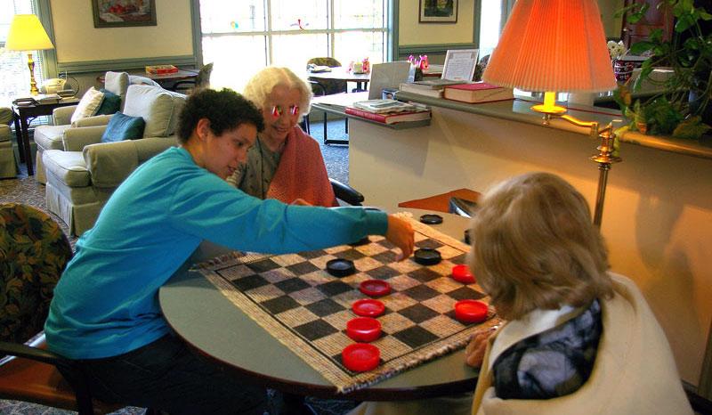 Enjoying a game of checkers at Lynn House.